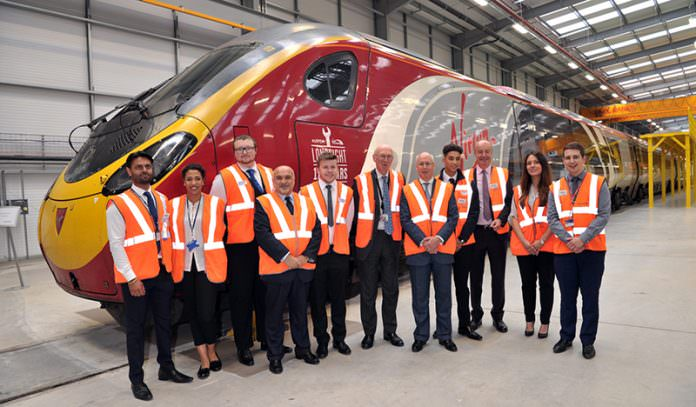 Staff at the launch of Alstom's train modernisation centre in Widnes. Credit: Alstom.