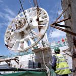 The lowering of the cutter head for one of the tunnel boring machines. Credit: Bechtel.